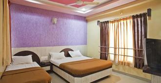 迪沙宮飯店 - Shirdi - 臥室