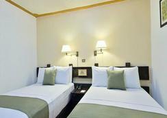 米西翁哈拉帕拉斯公約廣場酒店 - 哈拉帕 - 哈拉帕 - 臥室