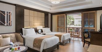 هينان لاجوون ريزورت - بوراكاي - غرفة نوم