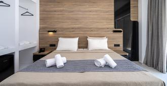كاستيلوم سويتس - بسعر شامل جميع الخدمات - مدينة رودس - غرفة نوم