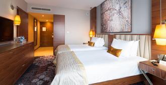 DoubleTree by Hilton Krakow Hotel & Convention Center - קראקוב - חדר שינה