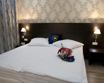 Hotel Gold Shark - Lobnya - Camera da letto