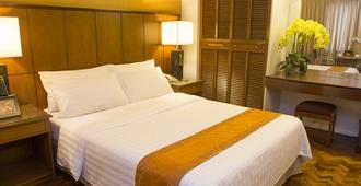 The Corporate Inn Hotel - Manila - Schlafzimmer