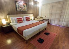 HM Suites & Studios - Bengaluru - Κρεβατοκάμαρα