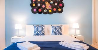 Vinyl Flat Bed & Breakfast - לאגוס - חדר שינה