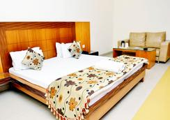 Hotel Mandakini Plaza, Kanpur - Kanpur - Schlafzimmer