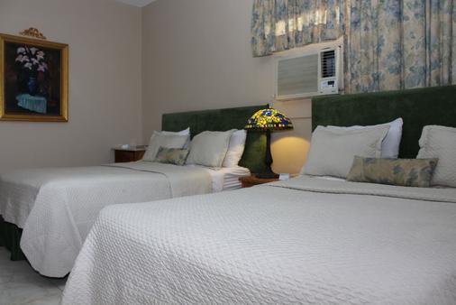 賈丁斯德特蒂羅公寓酒店 - 聖多明哥 - 聖多明各 - 臥室