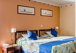 比萊夫體驗綠松飯店 - 式 - Varadero - 臥室