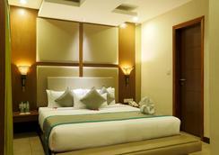 Mayflower Hotel - Guwahati - Bedroom