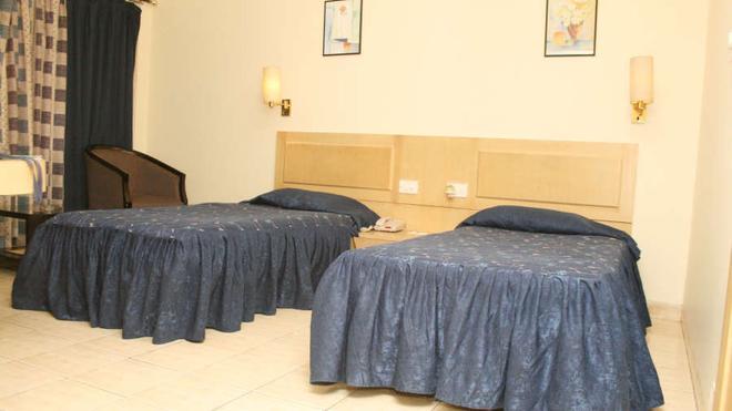 Vishwaratna Hotel - Guwahati - Makuuhuone