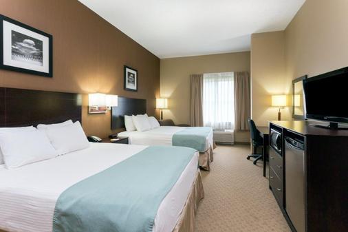 Days Inn by Wyndham Palm Coast - Palm Coast - Bedroom