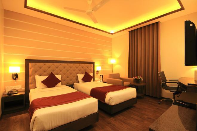 Hotel Naeeka - Ahmedabad - Makuuhuone