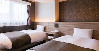 Nagai Park Hotel - אוסקה - חדר שינה