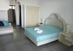 Suites Blue Hotel - Thera - Bedroom