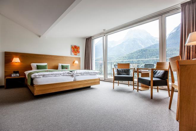 Engadiner Boutique-Hotel GuardaVal - Scuol - Habitación