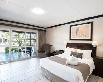 Arebbusch Travel Lodge - Windhoek - Bedroom
