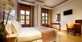 Exe Triunfo Granada - גרנדה - חדר שינה