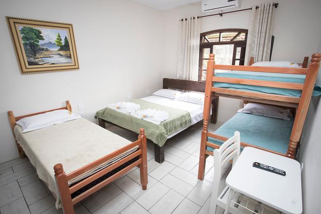 Hotel E Pousada Naturalis - Паранагуа - Спальня