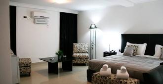 Hotel Portal del Norte - San Miguel de Tucumán - Schlafzimmer