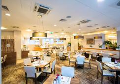 Hilton Garden Inn Krakow - Krakow - Restaurant