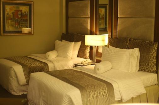Hospitality Inn - Lahore - Phòng ngủ