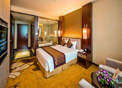 Muong Thanh Luxury Quang Ninh Hotel - הא לונג - חדר שינה