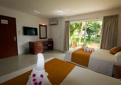 Hotel Dos Playas Faranda Cancún - Cancún - Phòng ngủ