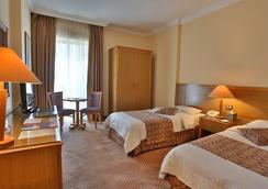 Alqasr Metropole Hotel - Αμμάν - Κρεβατοκάμαρα