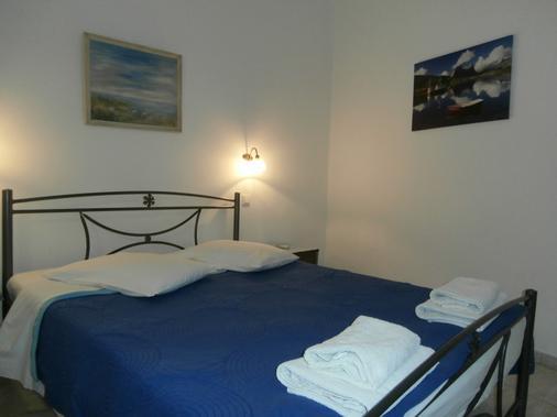 納基索斯酒店 - 聖托里尼 - 卡馬利 - 臥室