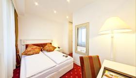 Hotel Unique Dortmund Hauptbahnhof - Dortmund - Phòng ngủ