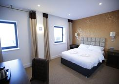 Grand Sapphire Hotel - Croydon - Schlafzimmer