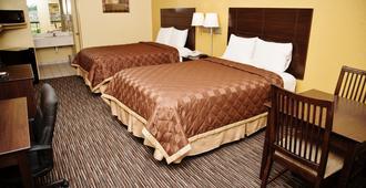 Winchester Inn & Suites Humble / IAH / Houston Northeast - Humble - Bedroom