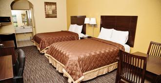 Winchester Inn & Suites Humble / IAH / Houston Northeast - Humble - Κρεβατοκάμαρα