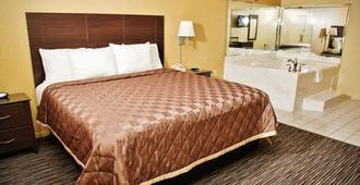 Winchester Inn & Suites Humble / IAH / Houston Northeast - האמבל - חדר שינה