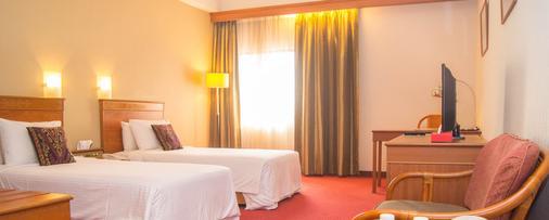 Hotel Grand Continental Kuching - Kuching - Bedroom