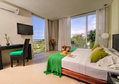 Santorini Hotel and Resort - Santa Marta - Schlafzimmer