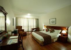 Hotel Pokhara Grande - Pokhara - Makuuhuone
