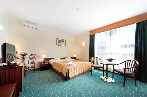 Hotel T&T - Πόζναν - Κρεβατοκάμαρα