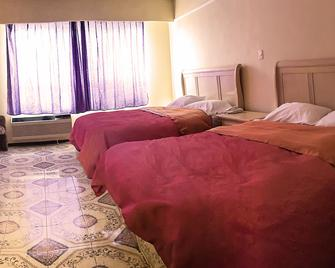 Hotel Posada del Sol Inn - Торреон - Спальня
