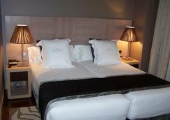 Washington Parquesol Suites & Hotel - Вальядолид - Спальня