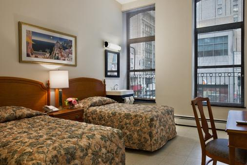 Americana Inn - New York - Schlafzimmer