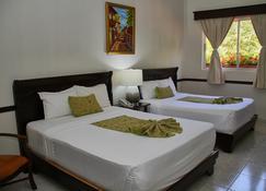 Platino Hotel & Casino - Santiago - Slaapkamer