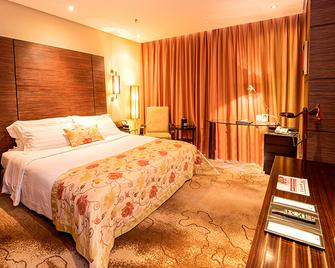 Mudu-Lee Royal International Hotel - Луойян - Спальня