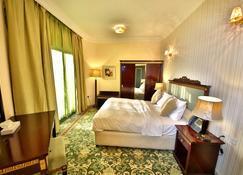 Midtown Furnished Apartments - Ajman - Habitación