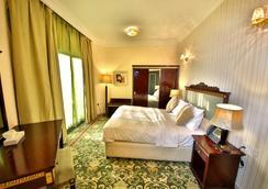 Midtown Furnished Apartments - Ajman - Quarto