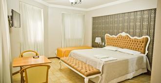 Seringal Hotel - מאנואס - חדר שינה