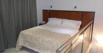 Hotel Athos - Buenos Aires - Camera da letto