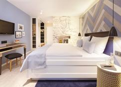 Küstenperle Strandhotel & Spa - Бюзум - Спальня