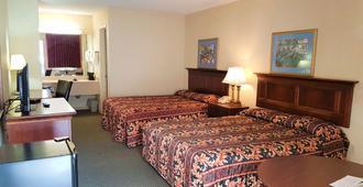Swiss Village Inn - יורקה ספרינגס - חדר שינה