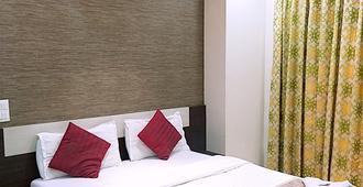 Nishita Residency - מומבאי - חדר שינה